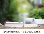 white coffee cup with notebooks ... | Shutterstock . vector #1164024256