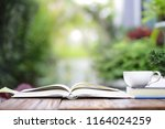 white coffee cup with notebooks ... | Shutterstock . vector #1164024259