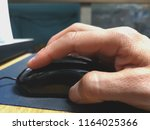 work on photo editing using the ...   Shutterstock . vector #1164025366