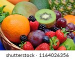 healthy fresh fruits in a... | Shutterstock . vector #1164026356