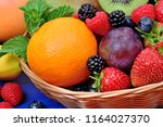 fresh fruits in a basket on... | Shutterstock . vector #1164027370