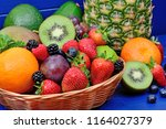 heap of different fruits and... | Shutterstock . vector #1164027379