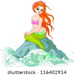 Beautiful Mermaid Girl Sittin...