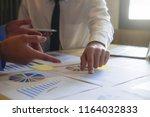 asian business adviser meeting... | Shutterstock . vector #1164032833