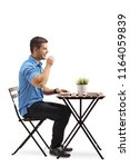 young man drinking coffee and... | Shutterstock . vector #1164059839