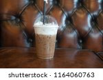 latte iced coffee on brown... | Shutterstock . vector #1164060763