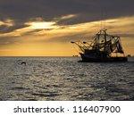 Fishing Boat Sailing Into...