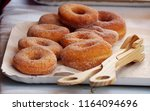 donuts with sugar on a tray in... | Shutterstock . vector #1164094696