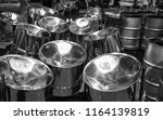various steel drums at a... | Shutterstock . vector #1164139819