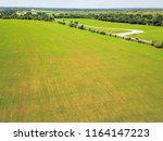 aerial view green farmland and... | Shutterstock . vector #1164147223