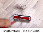 close up of a janitor cleaning... | Shutterstock . vector #1164147886