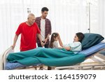 dramatic moment of family visit ... | Shutterstock . vector #1164159079
