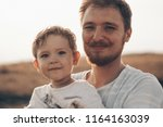 happy kid playing with father.... | Shutterstock . vector #1164163039