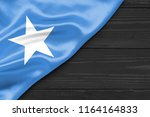 the somali flag is a place for... | Shutterstock . vector #1164164833