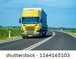 truck in the highway in poland. ... | Shutterstock . vector #1164165103