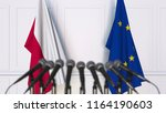 flags of poland and the... | Shutterstock . vector #1164190603