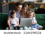 young family with kids using... | Shutterstock . vector #1164198226