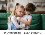 little boy hugging consoling... | Shutterstock . vector #1164198340