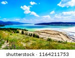 a large tailings pond along the ... | Shutterstock . vector #1164211753
