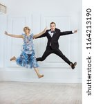 young couple jumping of joy and ... | Shutterstock . vector #1164213190