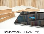 E-learning with e-book concept. Digital tablet in study room with button e-book on touch screen. - stock photo