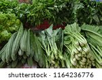 green vegetables in the local... | Shutterstock . vector #1164236776