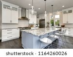 beautiful kitchen in luxury... | Shutterstock . vector #1164260026