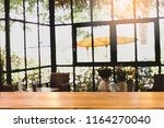 desk brown wooden at blurred... | Shutterstock . vector #1164270040