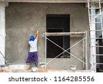 construction workers plastering ... | Shutterstock . vector #1164285556
