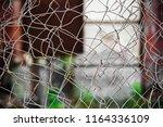 entangled metal mesh is close   Shutterstock . vector #1164336109