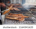 large barbecue of grilled pork... | Shutterstock . vector #1164341620