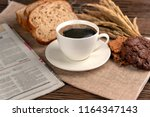 hot coffee cup and breakfast... | Shutterstock . vector #1164347143