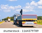truck with car trailer on the... | Shutterstock . vector #1164379789