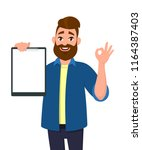 man holding showing a blank... | Shutterstock .eps vector #1164387403