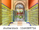 Hallway with traditional tiling giving acces to patio, Seville, Spain