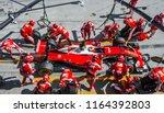 Small photo of SEPANG, MALAYSIA - OCTOBER 02, 2016 : Team members of Kimi Raikkonen of Scuderia Ferrari change tyre at pit stop during the Malaysia Formula One (F1) Grand Prix at Sepang International Circuit (SIC).