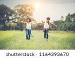 two little cute girls are... | Shutterstock . vector #1164393670