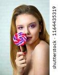 girl with big lollipop  sweet... | Shutterstock . vector #1164435319