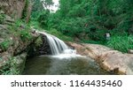 the waterfall nature view... | Shutterstock . vector #1164435460
