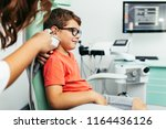 young boy at medical... | Shutterstock . vector #1164436126