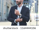 confident businessman. cropped... | Shutterstock . vector #1164444106