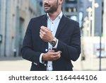 confident businessman. cropped... | Shutterstock . vector #1164444106