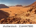 rocks and sand in wadi rum... | Shutterstock . vector #1164447880
