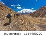 group of tourists climb the... | Shutterstock . vector #1164450220