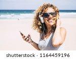 cheerful attractive beautiful... | Shutterstock . vector #1164459196