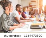 young trendy teamwork using... | Shutterstock . vector #1164473920