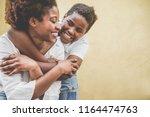 happy young mother having fun... | Shutterstock . vector #1164474763