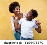 happy young mother having fun... | Shutterstock . vector #1164475870