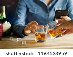 close up of two men clink... | Shutterstock . vector #1164533959