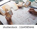 designer sketching drawing... | Shutterstock . vector #1164585646